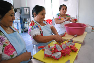 women cutting dragon fruit